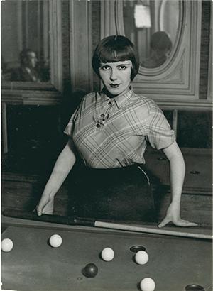 Brassaï, Fille de Montmartre playing Russian billiards,Blvd Rochechouart, 1932-33, Gelatin silver print.