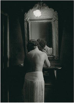 Brassaï, At Suzy's, fille de joie in mirror, 1932, Gelatin silver print