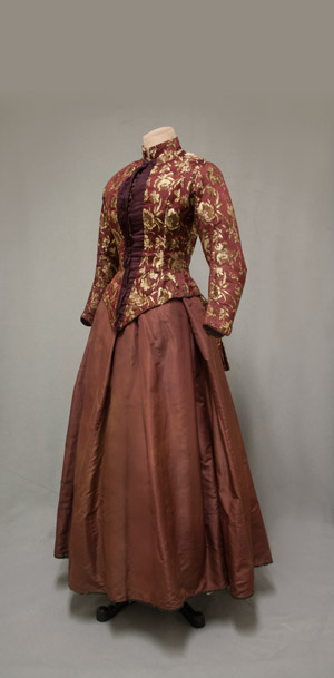 Cranberry brocade bodice and maroon silk taffeta skirt, 1880. 1974 gift from Mrs. Fitch Cheney to the University of Connecticut Historical Clothing and Textile Collection.