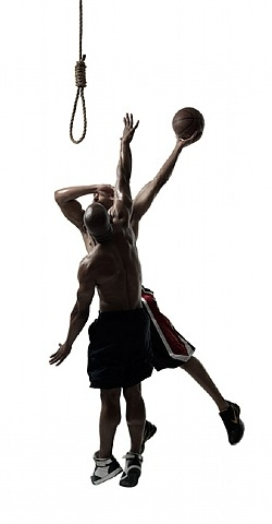 Two basketball players jumping to put basketball into a noose